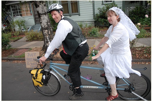 married couple on bikes