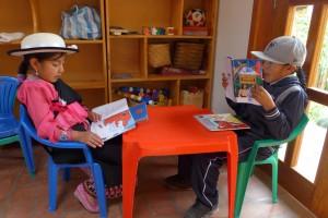 Scholarship program progeny in Judy's book corner